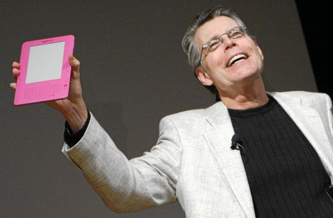 Author Stephen King Holds Up Pink Amazon Kindle 2 At News Conference In New York